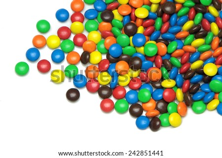 Colorful dragee candies on white background - stock photo