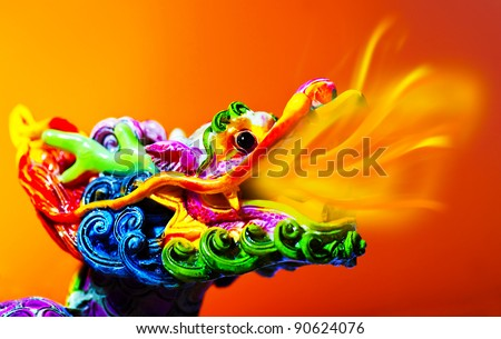 Colorful dragon head with tongue of fire flame, traditional Asian decoration and ornamental art, Chinese Zodiac, astrology sign, 2012 New Year symbol - stock photo