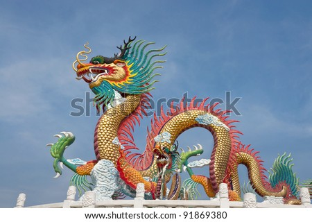 Colorful dragon statue on blue sky