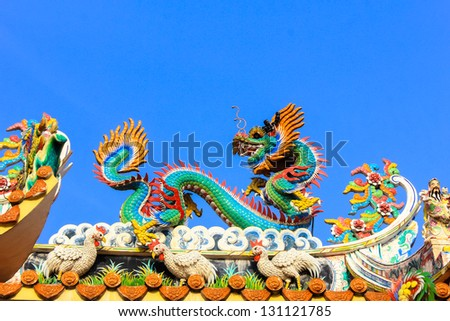 Colorful dragon statue with blue sky - stock photo