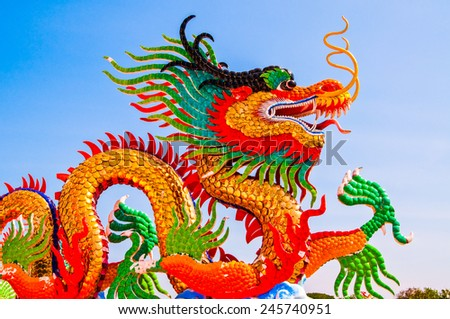 Colorful dragon statue with blue sky at public park, Thailand. - stock photo