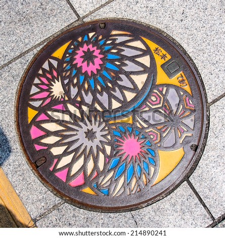 colorful drainage cover in Matsumoto city, Nagano, Japan - stock photo