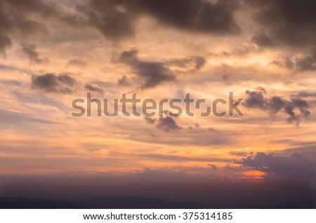 Colorful dramatic sky with cloud and mountain at sunset