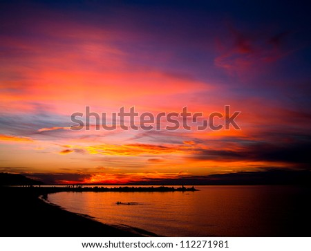 Colorful dramatic sunset at Sunken Meadow Park Long Island New York - stock photo