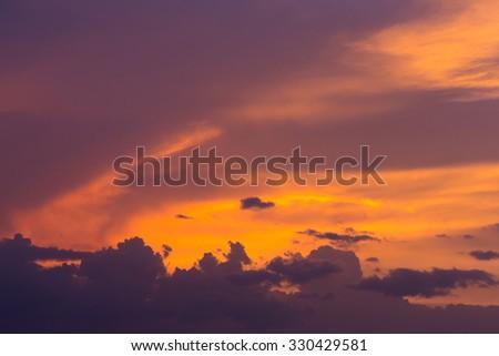 colorful dramatic sunset sky with orange cloud, twilight sky background - stock photo