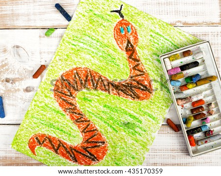 colorful drawing: snake in the grass - stock photo