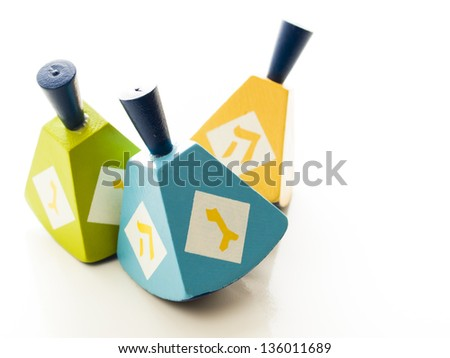 Colorful dreidels on white background. - stock photo