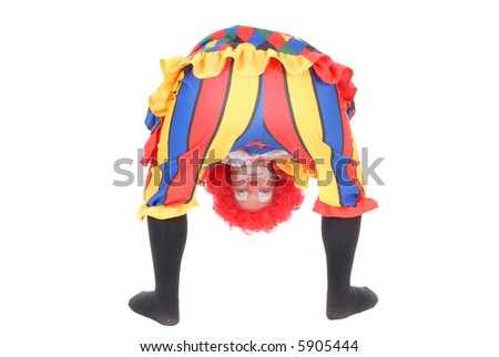 Colorful dressed female holiday clown, happy joyful expression on face,