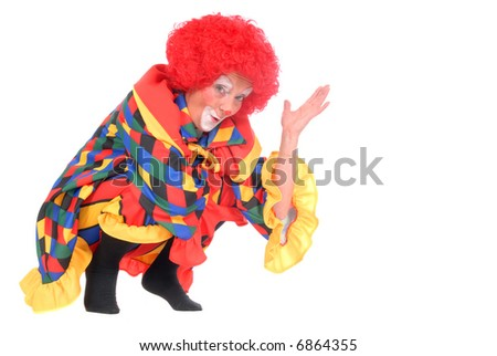 Colorful dressed female holiday clown, happy joyful expression on face, making funny gestures with hands - stock photo