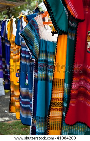 Colorful dresses on a rope line - stock photo
