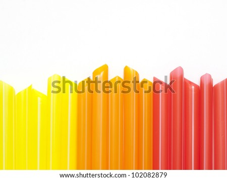Colorful drinking straws background and copy space - stock photo