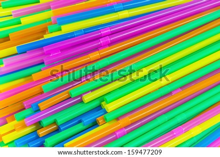 Colorful drinking straws close-up background, colorful plastic tubes backgrou and textures