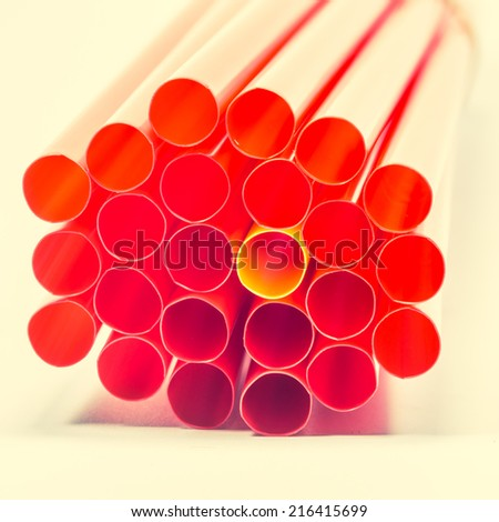 colorful drinking straws. Vintage filter. - stock photo