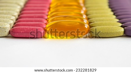 Colorful drugs top border on white background, copyspace - stock photo