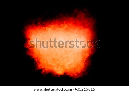 Colorful dust particle explosion resembling a fire explosion over black. Closeup isolated on black with copy space - stock photo