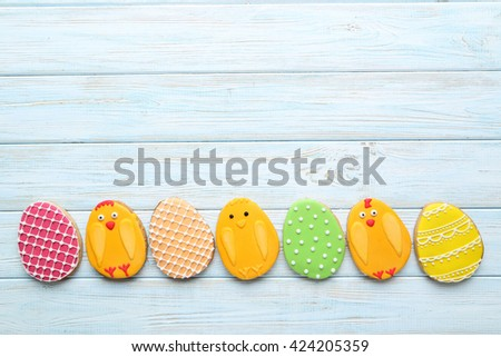 Colorful easter cookies on blue wooden background - stock photo