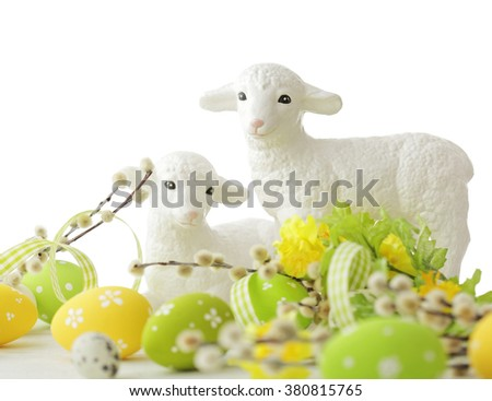 colorful easter decoration with eggs and sheep on white background - stock photo