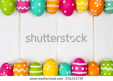 Colorful Easter egg double edge border against white wood               - stock photo