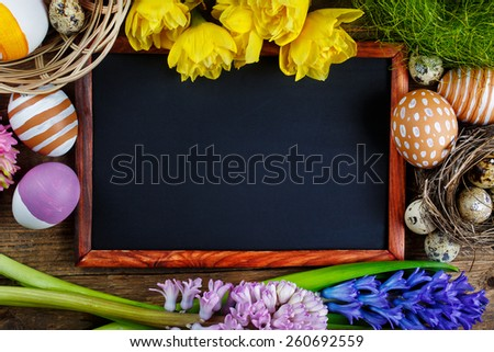 Colorful Easter eggs and Black board, Top view - stock photo