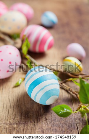 Colorful Easter eggs and branch tree with spring buds - stock photo