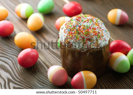 Colorful Easter Eggs and Cake - stock photo