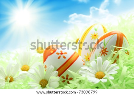 Colorful Easter Eggs and Daisy on Green Grass,Shallow Dof. - stock photo