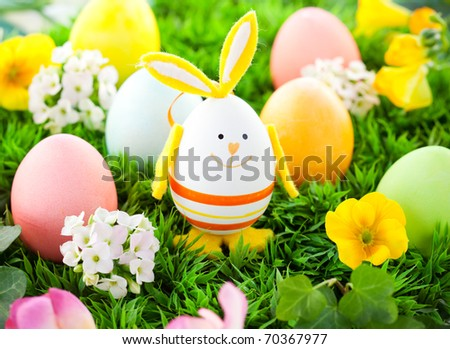 colorful Easter Eggs and rabbit on the grass - stock photo