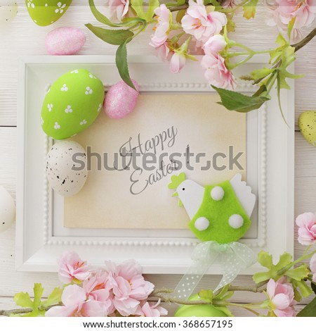 colorful easter eggs and spring flowers frame - stock photo