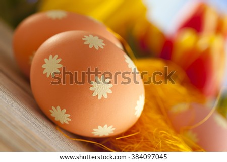Colorful Easter eggs and tulips - stock photo