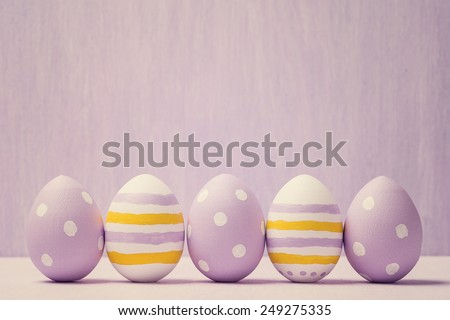 Colorful easter eggs. Background with easter eggs. With retro filter effect. - stock photo