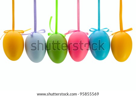 Colorful Easter eggs hanging on ribbons. Isolated. - stock photo