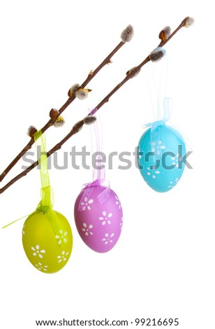 Colorful easter eggs hanging on ribbons isolated on white - stock photo