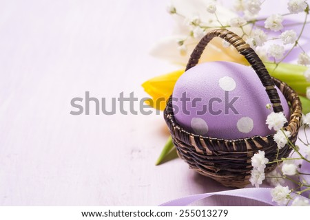 Colorful Easter eggs in a basket. Space for text - stock photo