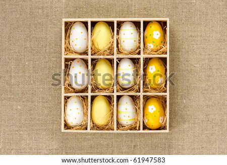 Colorful Easter eggs in a box - stock photo