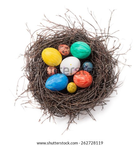Colorful Easter eggs in a nest on a white background. Top view - stock photo