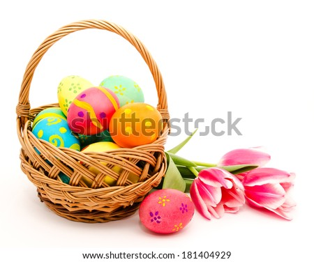 Colorful easter eggs in basket and flowers isolated on a white background - stock photo