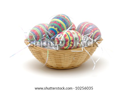 Colorful easter eggs in basket, isolated on white