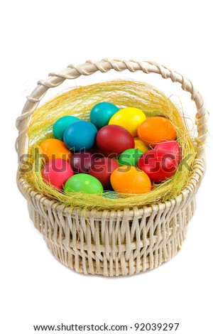 colorful easter eggs in basket isolated on white background