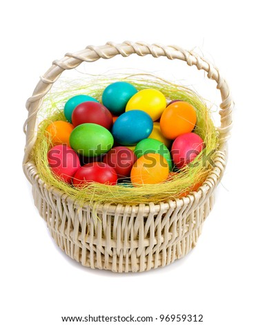 colorful easter eggs in basket isolated on white background - stock photo