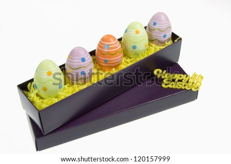 Colorful Easter Eggs in Box on White Background - stock photo
