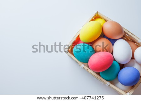 Colorful easter eggs in box on white table. happy easter!!! - stock photo