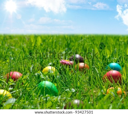 colorful easter eggs in green grass - stock photo