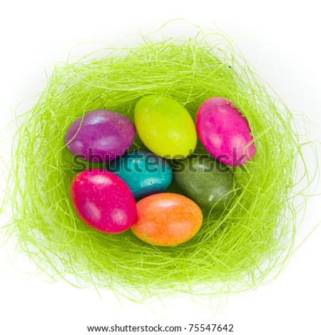 colorful easter eggs in nest isolated - stock photo