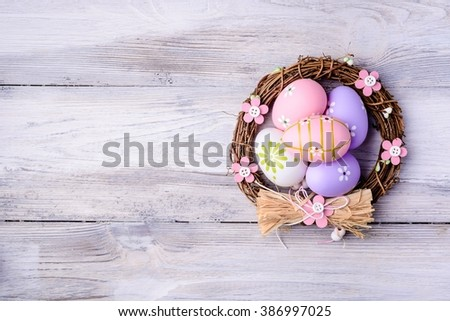Colorful Easter eggs in nest on old cracked wooden background. Copyspace.  Easter concept. Happy Easter !