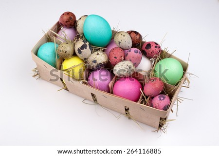 Colorful easter eggs in packing box isolated on white  - stock photo