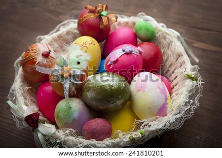 colorful Easter eggs in the basket - stock photo