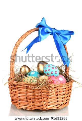 Colorful Easter eggs in the basket with a blue bow isolated on white