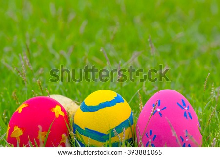 Colorful Easter eggs in the grass on the green grass-colorfull