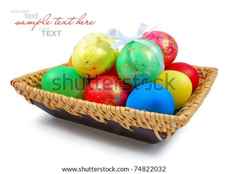 Colorful easter eggs in the wattled dish on white background