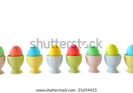 Colorful Easter Eggs in vintage pastel cups in a row  isolated on a white background
